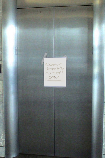 """Saw this at the mall:  """"Elevator temporally out of order"""""""