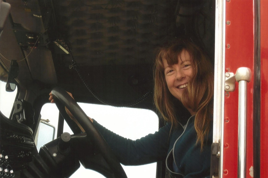 My short but thrilling trucking career (note the wild hair – we had the windows open so I could enjoy the sound of the engine).